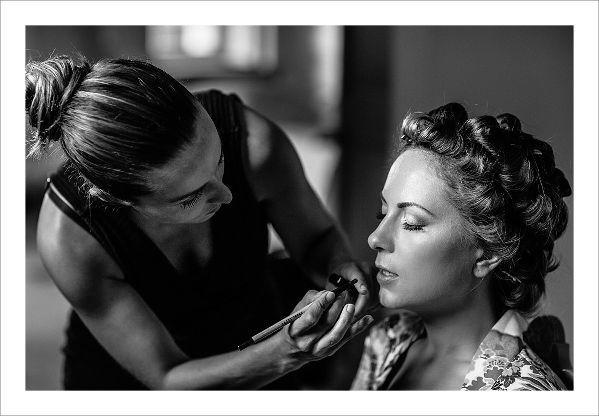 makeup artist working on Anne's makeup