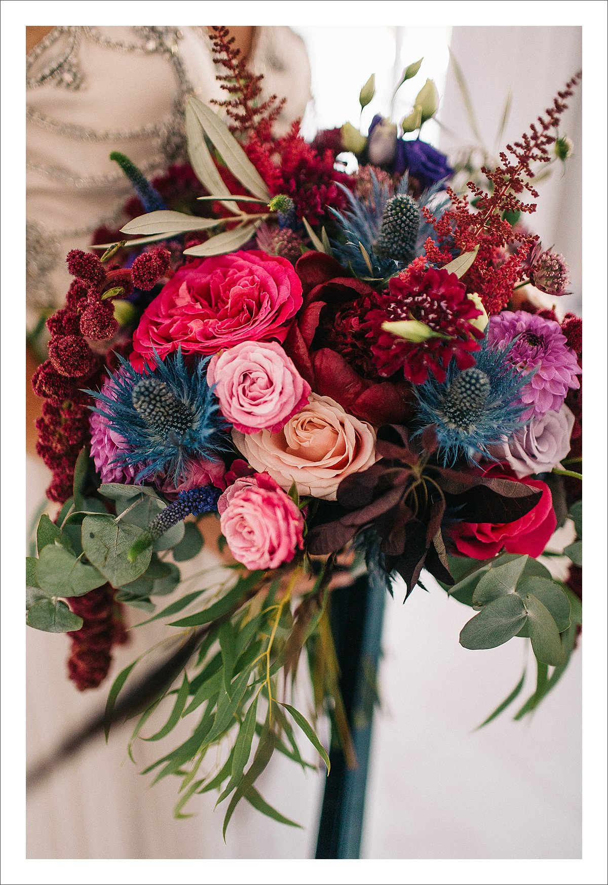 deep burgundy, pink and blue colourful bridal bouquet