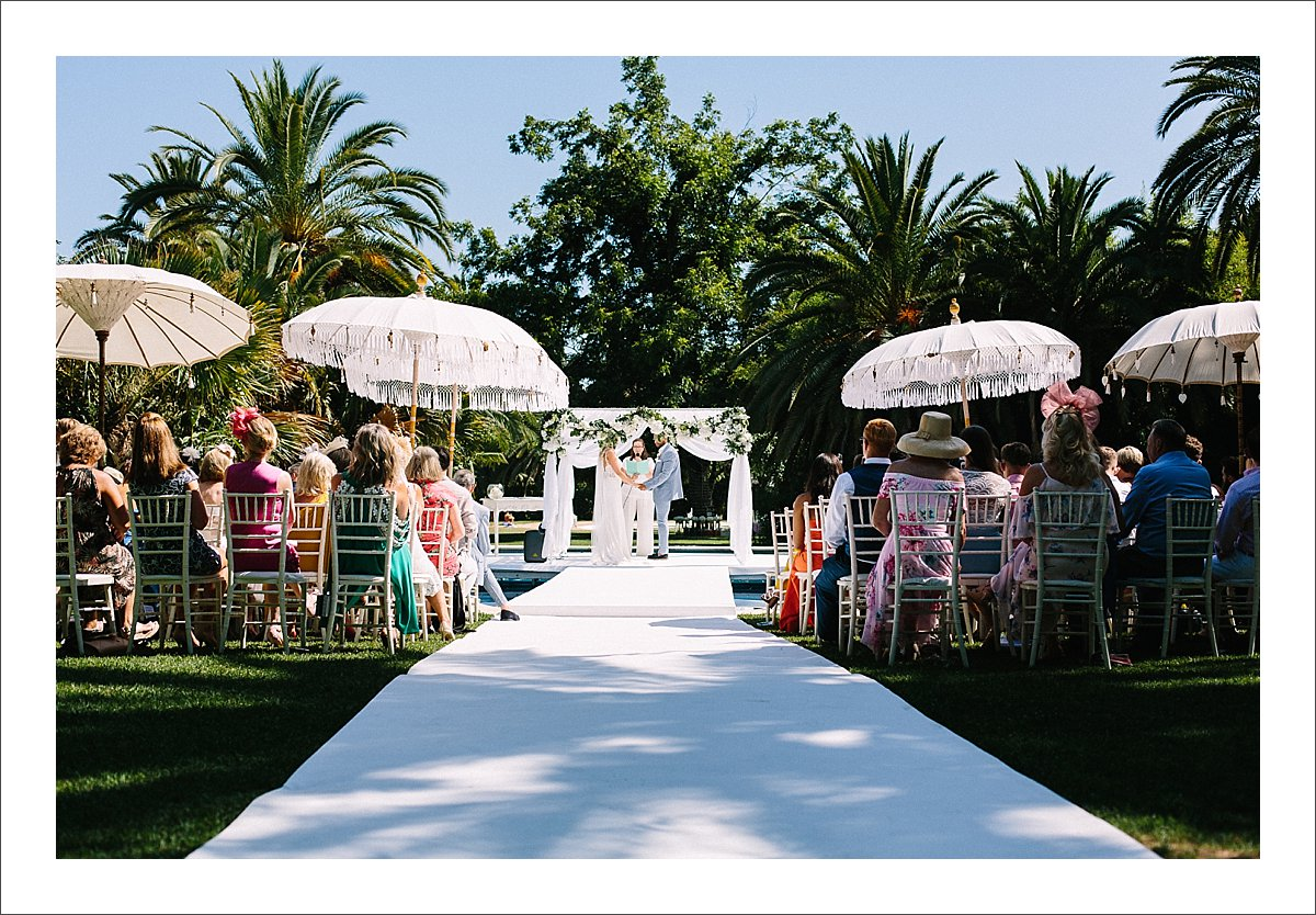 wedding ceremony over a pool in Finca La Concepcion in Marbella